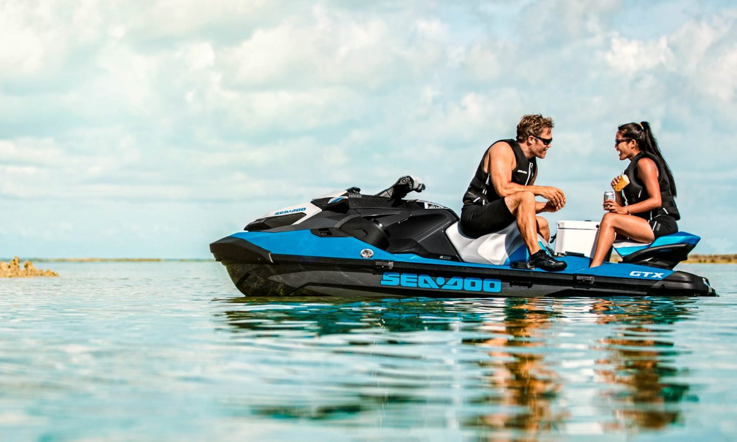 Couple having lunch on a Sea-Doo GTX
