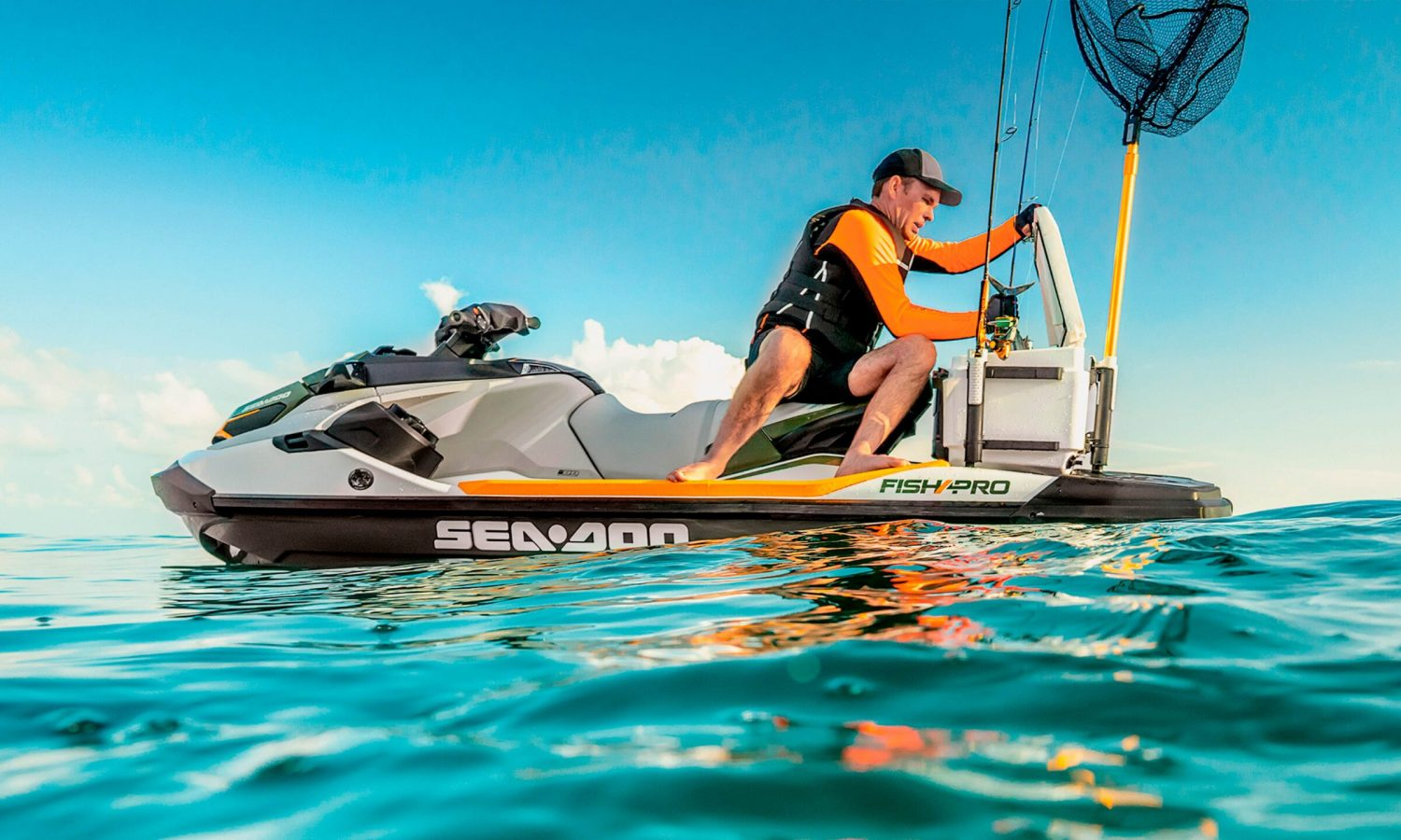 Fisherman is putting his fish in the Sea-Doo FISH Pro cooler