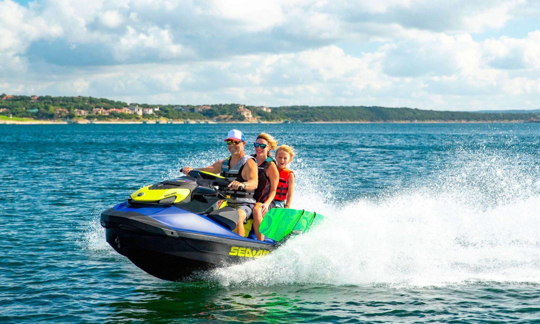 Family riding on a Sea-Doo WAKE