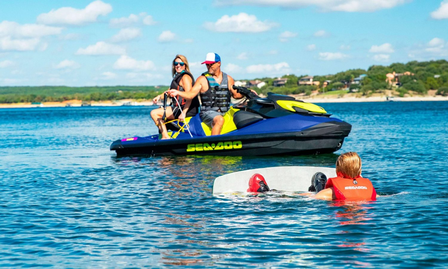 Parents on Sea-Doo Wake and kid the in water